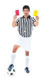 Serious referee showing red and yellow card Royalty Free Stock Photos