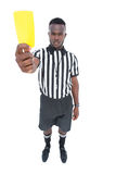 Serious referee showing yellow card Royalty Free Stock Image