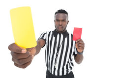 Serious referee showing yellow and red card Royalty Free Stock Photo