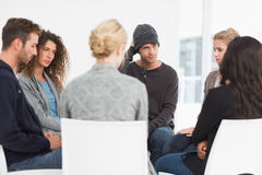 Serious rehab group at a therapy stock photo