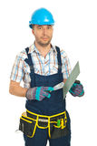 Serious repairman with notched Royalty Free Stock Photo