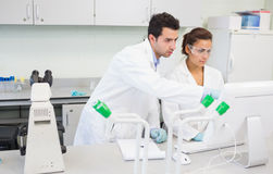 Serious researchers using a computer in the lab Stock Image