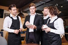 Serious restaurant manager dividing responsibilities among waite royalty free stock photography