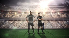 Serious rugby players posing in front of goal post stock video footage