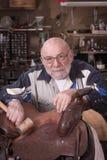 Serious saddle artist Stock Photos