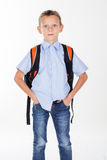 Serious school boy with bag Stock Photo