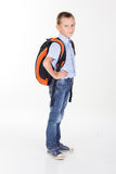 Serious school boy with bag isolated on white background Stock Photography