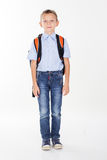 Serious school boy with bag isolated on white background Stock Photos