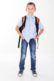 Serious school boy with bag isolated on white Royalty Free Stock Photo
