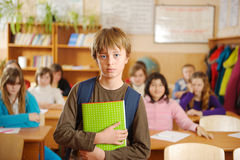 Serious schoolboy in front of class Royalty Free Stock Photography