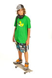 Serious schoolboy teen on skateboard Royalty Free Stock Image