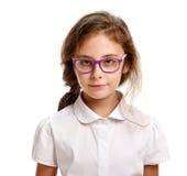 Serious schoolgirl in glasses Stock Photo