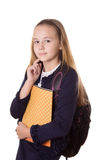 Serious schoolgirl in uniform and with bag Royalty Free Stock Photo