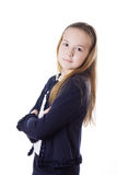 Serious schoolgirl in uniform lookig stright Stock Photography