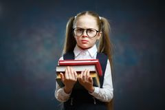 Serious Schoolgirl Wear Glasses Hold Pile of Book stock photography