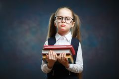 Serious Schoolgirl Wear Glasses Hold Pile of Book royalty free stock images