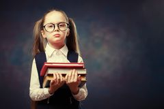 Serious Schoolgirl Wear Glasses Hold Pile of Book. Color Tone stock photos