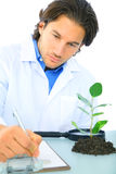 Serious Scientist Writing Research Report. About his subject stock photo
