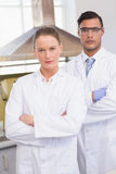 Serious scientists looking at camera with arms crossed Stock Images