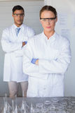 Serious scientists looking at camera arms crossed Royalty Free Stock Photo