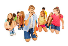 Serious search of school kids with magnifier Royalty Free Stock Image