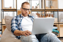 Serious self employed man working on a laptop Royalty Free Stock Images