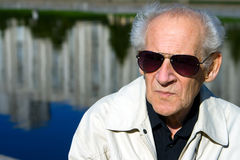 Serious Senior. Face portrait of an old serious senior in sunglasses Stock Photography