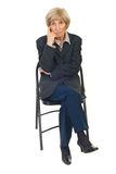 Serious senior business woman on chair Stock Photo