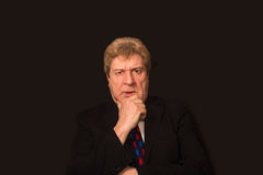 The serious senior businessman Stock Photo