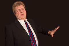 Serious senior businessman showing stop gesture. With disgust on his face royalty free stock photos