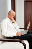 Serious senior businessman working Stock Photo
