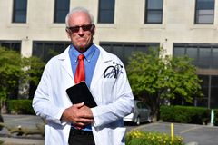 Serious Senior Male Surgeon At Hospital. A retired senior adult male Stock Photos