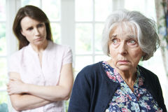 Serious Senior Woman With Adult Daughter At Home Royalty Free Stock Photography