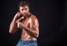 Serious shirtless mascular man Stock Image