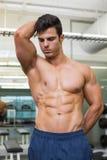 Serious shirtless muscular man in gym Royalty Free Stock Images