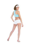 Serious slender woman wearing sportswear posing with hand on hips Stock Image