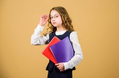 Serious small girl wants to be teacher. hometwork. notebook for diary notes. study lesson. knowledge and education. Back stock image