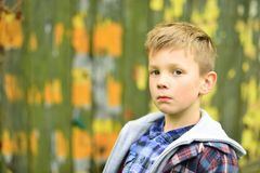 Serious and smart. Serious boy. Small boy look serious. Small child with thinking face. Focusing on something.  stock photos