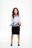 Serious smart young asian businesswoman standing and showing colorful folders Royalty Free Stock Photography