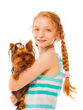 Serious smiling girl holding little cute dog Royalty Free Stock Images
