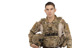 Serious soldier posing against white background Stock Image