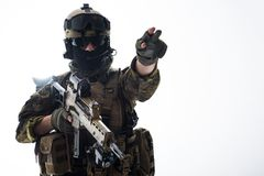 Serious soldier showing sign by arm Royalty Free Stock Photography