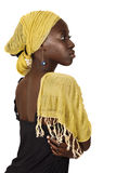 Serious South African woman with yellow scarf. Beautiful South African young woman with head wrapped in traditional style yellow scarf looking seriously in Royalty Free Stock Photography