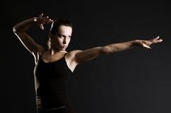 Serious sportswoman in pose. Over dark background Stock Photo
