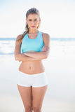Serious sporty blonde in sportswear posing Stock Photography