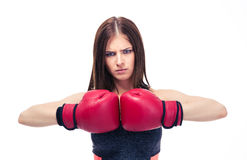 Serious sporty woman with boxing gloves Royalty Free Stock Photography