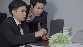 Serious stressed two business man using a laptop computer to working project. Serious stressed two business man using laptop computer to working project stock footage