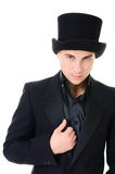 Serious strick man illusionist in black Stock Photos