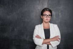 Serious strict teacher looking at you on blackboard royalty free stock images