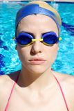 Serious strong professional female swimmer portrait. Concentrated female swimmer before race Royalty Free Stock Images